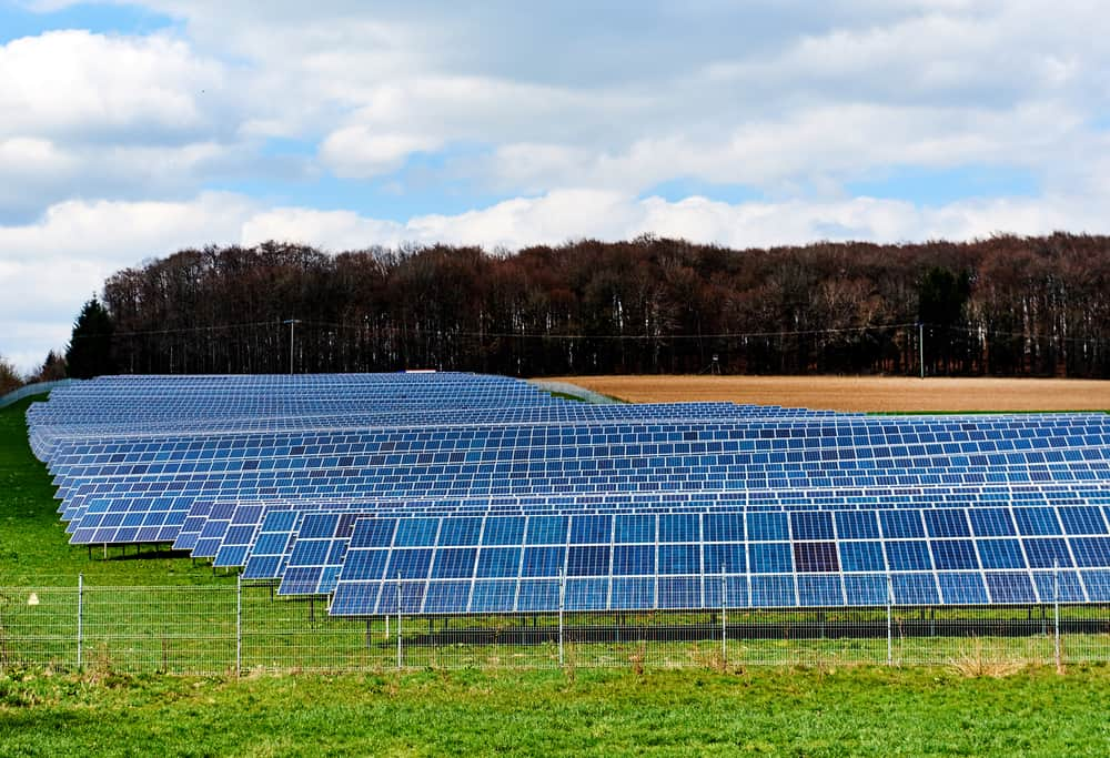 Solar panels on a green field